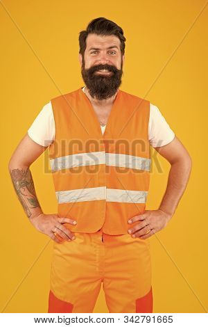 Safety equipment concept. Safety apparel for construction industry. Bearded brutal hipster safety engineer. High visibility reflective safety vest. Man worker protective uniform orange background. stock photo