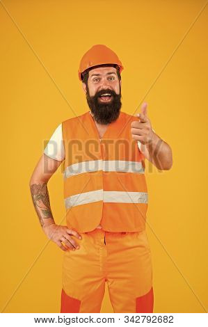Man engineer protective uniform orange background. Engineering career concept. Architect builder engineer. Good job. Safety apparel for construction industry. Bearded brutal hipster safety engineer. stock photo