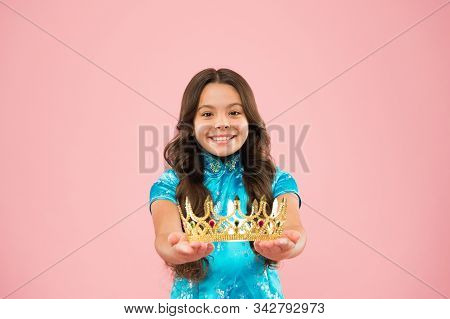 Winner of beauty competition. International beauty contest. Kid wear golden crown symbol of princess. Become princess. Lady little princess. Girl wear crown. Princess manners. Award concept. stock photo