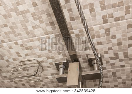 Water tap in the bathroom close-up. Hard water. Plaque on the tap from dirty water. stock photo