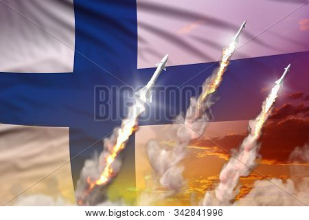 Modern strategic rocket forces concept on sunset background, Finland supersonic missile attack - military industrial 3D illustration, nuke with flag stock photo