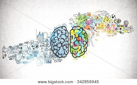 Bright brain sketch and business plan icons drawn on concrete wall. Concept of creative thinking and brainstorming stock photo
