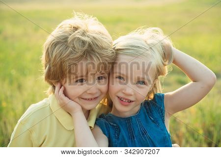 Valentines Day for Valentine love couple. Beautiful little couple - boy and girl embracing. Child care. Beautiful little couple - boy and girl embracing stock photo