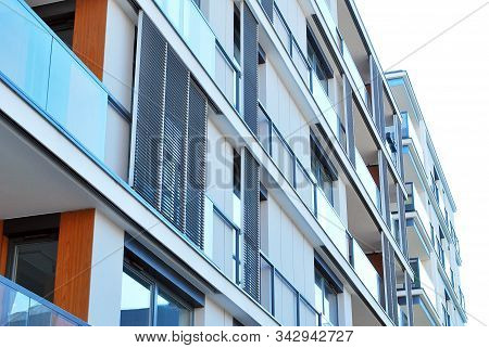 Modern apartment buildings on a sunny day with a blue sky. Facade of a modern apartment building stock photo