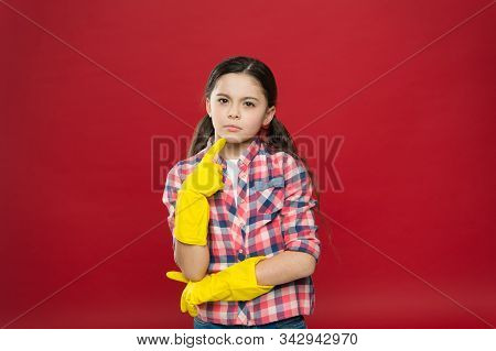 So fresh and so clean. Thoughtful child wear rubber gloves red background. Household work. Housekeeping routine. Cleaning service. Cleaning and sanitation. Clean up. Keep home clean. House clean. stock photo