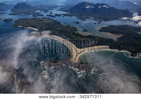 Aerial view of beautiful Beach on the Pacific Ocean Coast during a sunny summer morning. Taken in Tofino, Vancouver Island, British Columbia, Canada. stock photo