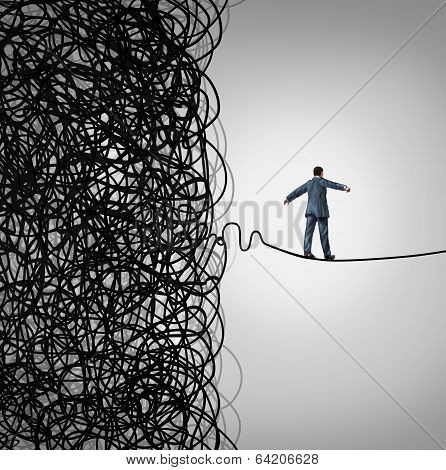 Crisis Management business concept as a tightrope walker walking out of a confused tangled chaos of wires breaking free to a clear path of risk opportunity as a metaphor for managing organizational challenges for financial freedom and success. stock photo