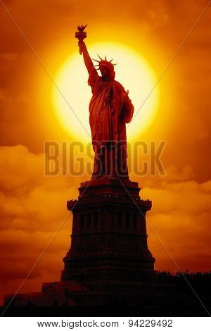 An image of the liberty statue at sunset-Lg Fridge Magnet Skin (size 36x65)