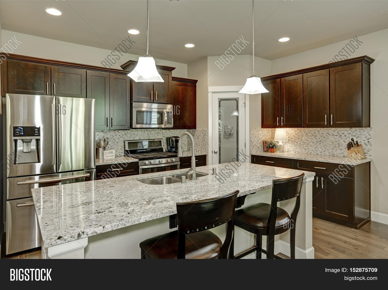Kitchen,interior,room,apartment,home,house,flat,architecture,bright,new,clean,shiny,elegant,estate,design,cabinets,hardwood,wood,furnished,furniture,stove,white,wall,ceiling,appliances,modern,pendant,granite,northwest,sink,stainless,steel,top,stool,large,windows,renovated,counter,lights,pantry,back,splash,trim