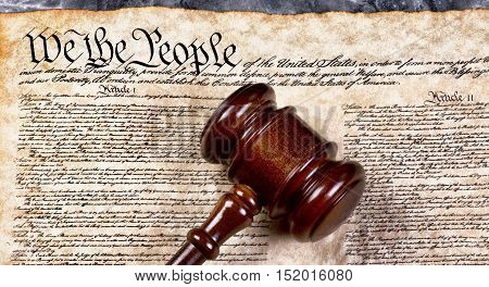 Wooden gavel on top of American Bill of Rights document We the People. stock photo