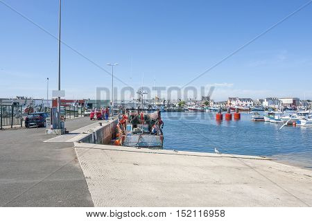 harbor scenery at Le Guilvinec a commune in the Finistere department of Brittany in north-western France. stock photo