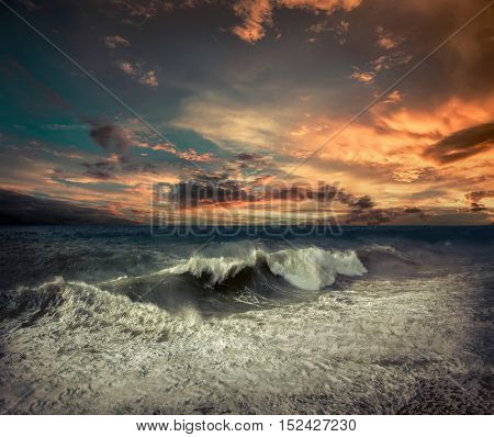 View of great storm on the sea. Strong wind and big waves with splash drops under dark sky. stock photo