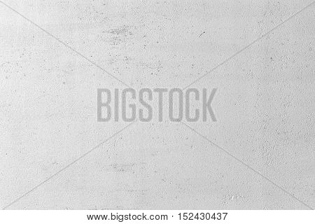 Grungy white concrete wall background. Background from high detailed fragment stone wall. Cement texture. Grey concrete wall. stock photo