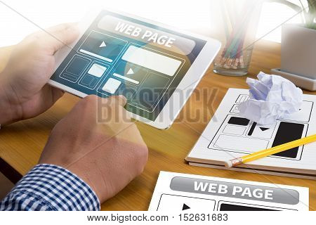 Web Design Template and web page Closeup shot of laptop with digitaltablet and smartphone on desk. Responsive design web page Modern people doing business graphs and charts being demonstrated on the screen of a touch-pad stock photo