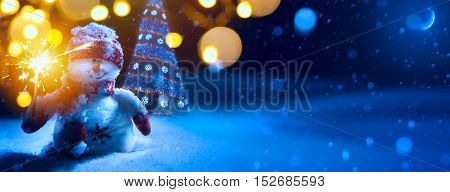 Christmas background with Christmas tree and holidays ornament on blue background