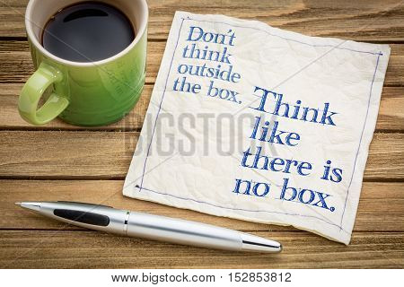 Don't think outside the box. Think like there is no box.- handwriting on a napkin with a cup of espr