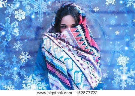 Young beautiful woman freeze in winter, cold weather. Coldly. Snowflakes.