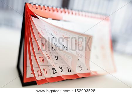Months and dates shown on a calendar whilst turning the pages stock photo