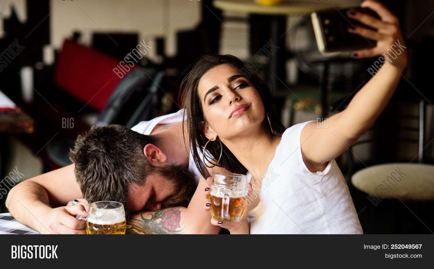 Take Selfie To Remember Great Event. Woman Making Fun Of Drunk Friend. Man Drunk Fall Asleep Table A