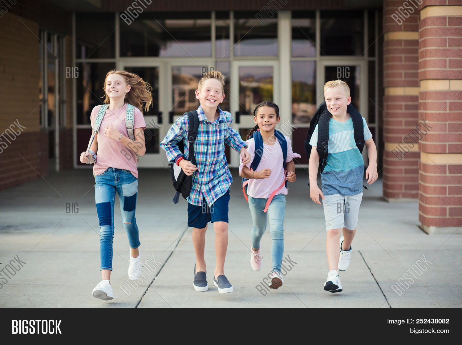 adolescent,african american,back to school,backpack,beautiful,black,blonde,boy,boys,building,child,childhood,children,cute,diverse,diversity,door,educate,education,elementary,end of the day,entrance,ethnicity,four,freedom,girl,girls,grade,group,growing up,happy,kid,kids,kindergarten,learning,leaving,little,outdoors,outside,ready,running,school,school kids,siblings,smiling,standing,student,students,summer,young