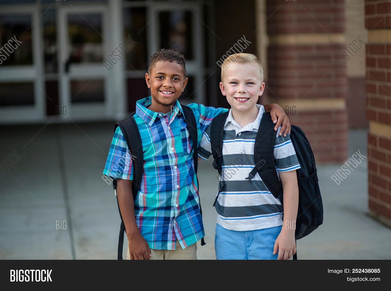 african american,arms around,backpack,beautiful,black,blond,building,child,childhood,children,copy space,cute,diverse,diversity,doors,educate,education,elementary,entrance,ethnicity,expression,friend,friends,friendship,front door,grade,group,hanging out,happy,hispanic,kid,kids,learning,little,outside,playful,playground,portrait,school,school kids,smile,standing,student,students,talking,together,togetherness,two,walking
