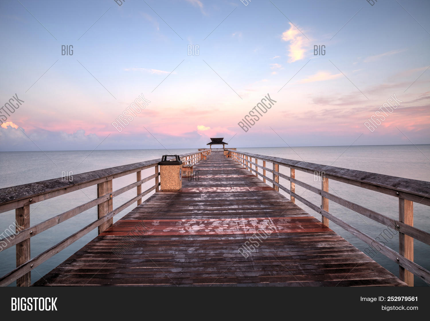 Early sunrise over the Naples Pier on the Gulf Coast of Naples, Florida in summer.