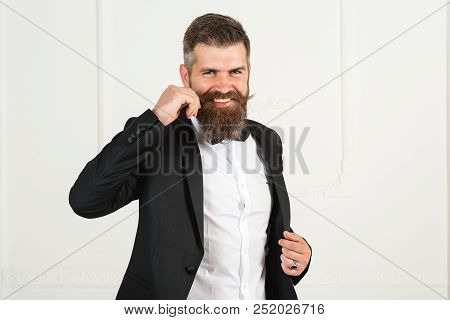 Surprised hipster in hairdressing salon. Portrait of stylish man and beard. Brutal bearded man, bearded male. Barber scissors, straight razor, barber shop. Vintage barbershop, shaving. Black and white stock photo