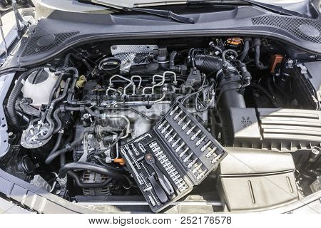 Top vertical view of car engine bay and open tool box with specialized tools like gedore and torx. stock photo