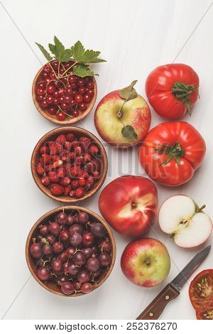Assortment of red foods on a white background, top view. Fruits and vegetables containing lycopene. Healthy vegan food background. stock photo