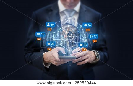 Businessman using mobile smart phone, and augmented reality with social media, network notification icons. Element of this image are furnished by NASA stock photo