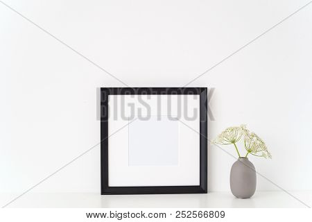 Minimal elegant black portrait square frame mock up with a Aegopodium podagraria in gray vase. Mockup for quote, promotion, headline, design. Template for small businesses, lifestyle bloggers, social media stock photo