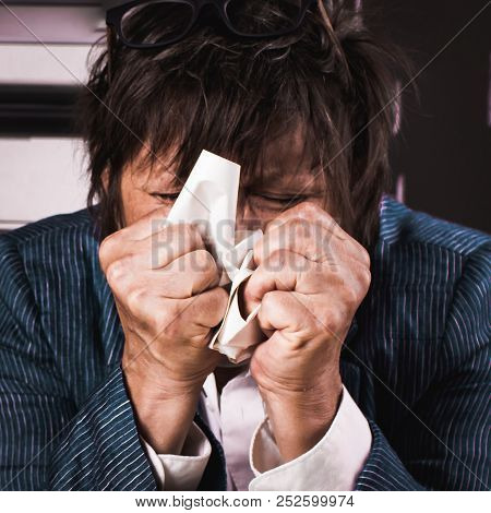 Portrait of hopeless adult women. Negative emotions, tension. Hands are clenched into fists, inside, close-up stock photo