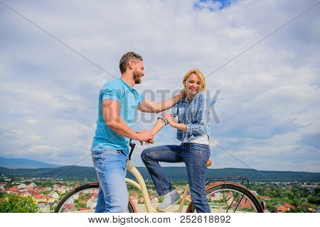 Man with beard and shy blonde lady on first date. How to meet girls while riding bike. Picking up girl. Couple just meet to become acquainted. Woman feels shy in company with attractive macho stock photo