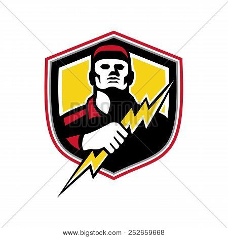 Mascot icon illustration of bust of a power lineman or electrician holding a thunderbolt or lightning bolt  viewed from front set inside crest or shield on isolated background in retro style. stock photo