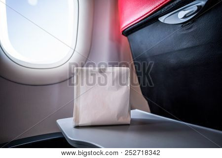 Airsick nauseous person in the air sickness vomit bag prepared to vomit stock photo
