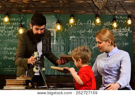 Teacher Or Tutor Helps Preschool Child, University Students Studying With Books In Library, Teachers