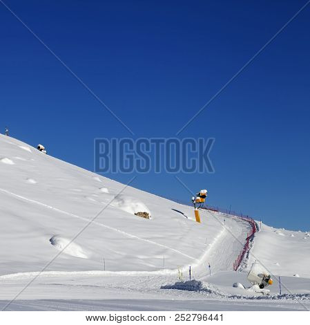 Snowy ski slope with snowmaking at sun day. Caucasus Mountains in winter, Shahdagh, Azerbaijan. Square photo. stock photo