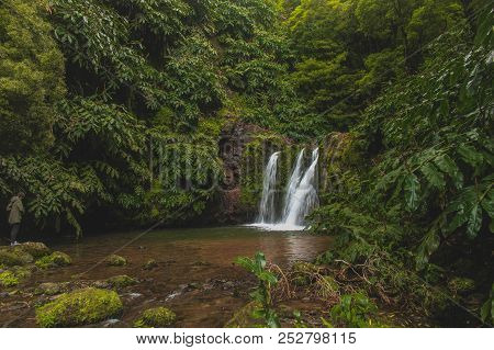 Waterfalls in Azores always provide a very high contrast against the lush greens of the island. They can be found in many places as Azores has many hills and steep terrain created by volcanic activity, shaping the land in a way that creates cascades, wate stock photo