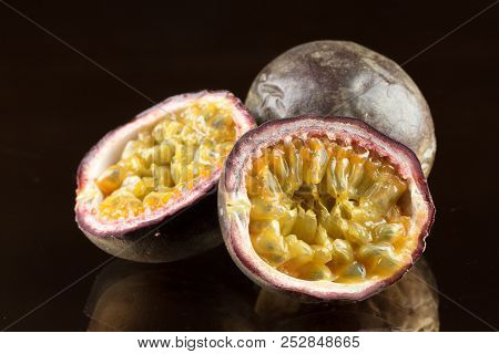 yellow passion fruit on wood background. macro photography. close up. object. stock photo