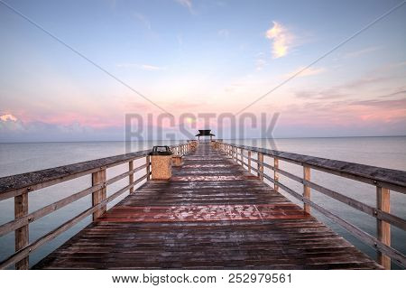 Early sunrise over the Naples Pier on the Gulf Coast of Naples, Florida in summer. stock photo