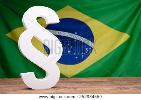 Close-up Of White Paragraph Symbol In Front Of Brazil Flag stock photo