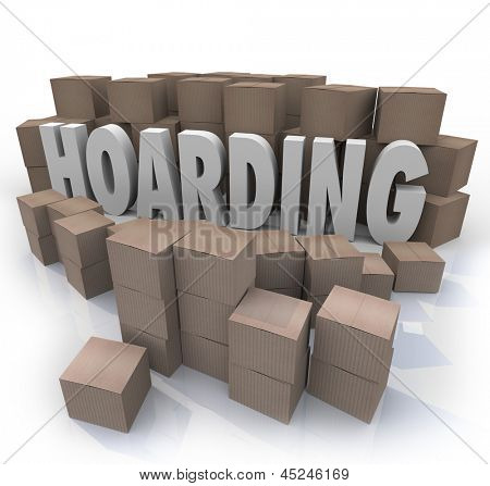 The word Hoarding surrounded by cardboard boxes piled up in an out of control messy collection of items, junk and trash stock photo