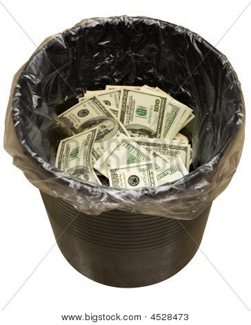 A money is in a trash bucket. Isolated on white [with clipping path]. stock photo