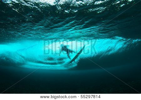 Surfer on tropical wave underwater vision