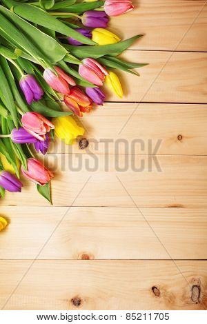 Spring Flowers bunch at wood floor texture. Beautiful Tulips bouquet gift. Easter or Mother's Day  b-Dishwasher Magnet Skin (size 24x24)