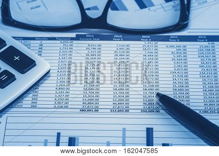 Accounting financial bank banking account stock spreadsheet data for accountant  with glasses pen and calculator in blue analysis analyst analyzer stock photo