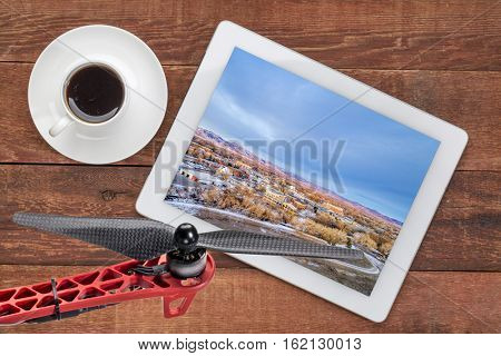 aerial view of Fort Collins downtown, Poudre River and a bike trail on digital tablet with coffee and drone propeller, screen image  stock photo