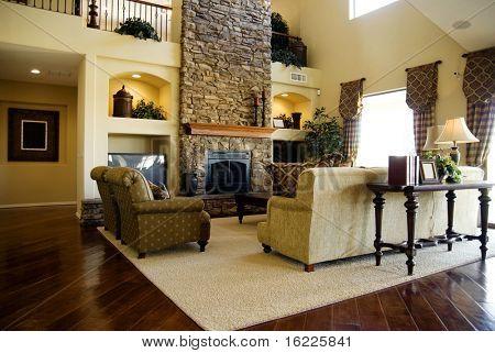 Beautiful large executive home living room area with lush polished hardwood flooring stock photo