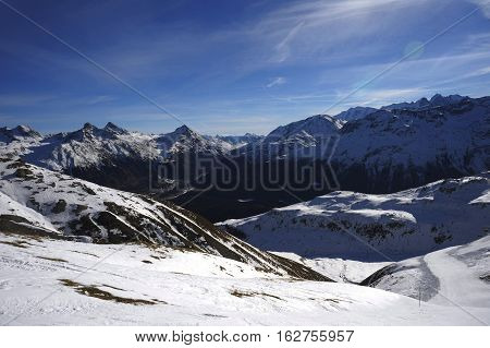 amazing scenic view of snow mountains and ski resort in Switzerland Europe on a cold sunny day with blue sky at Saint Moritz Corvatsch peak in Engadin in winter vacation and holiday concept stock photo
