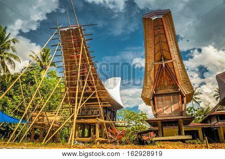 Photo of building up of wooden tongkonan traditional ancestral house with boat-shaped roof in Lemo Toraja region in Sulawesi Indonesia. stock photo